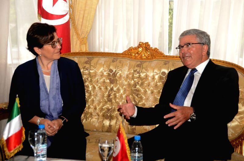 TUNIS, July 23, 2018 - Tunisian Defense Minister Abdelkarim Zbidi (R) meets with his Italian counterpart Elisabetta Trenta in Tunis, Tunisia, on July 23, 2018. - Abdelkarim Zbidi