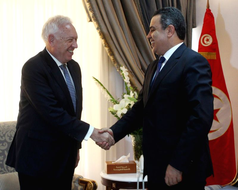 Tunisian Prime minister Mehdi Jomaa (L) shakes hands with Spanish Foreign minister Jose Manuel Garcia-Margallo in Tunis, Tunisia on July 24, 2014.