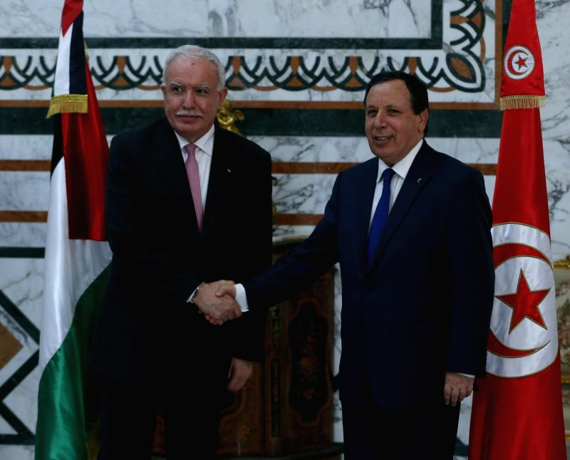 """TUNIS, June 5, 2017 - Tunisian Minister of Foreign Affairs Khemaies Jhinaoui (R) meets with his Palestinian counterpart Riyad al-Malki in Tunis, Tunisia, on June 5, 2017. """"Tunisia is following ..."""