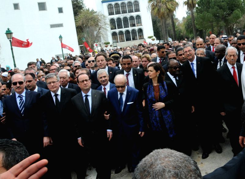 Tunisian President Beji Caid Essebsi(4th L, front) and French President Francois Hollande(3rd L, front) take part in the international anti-terrorism march in Tunis, ...
