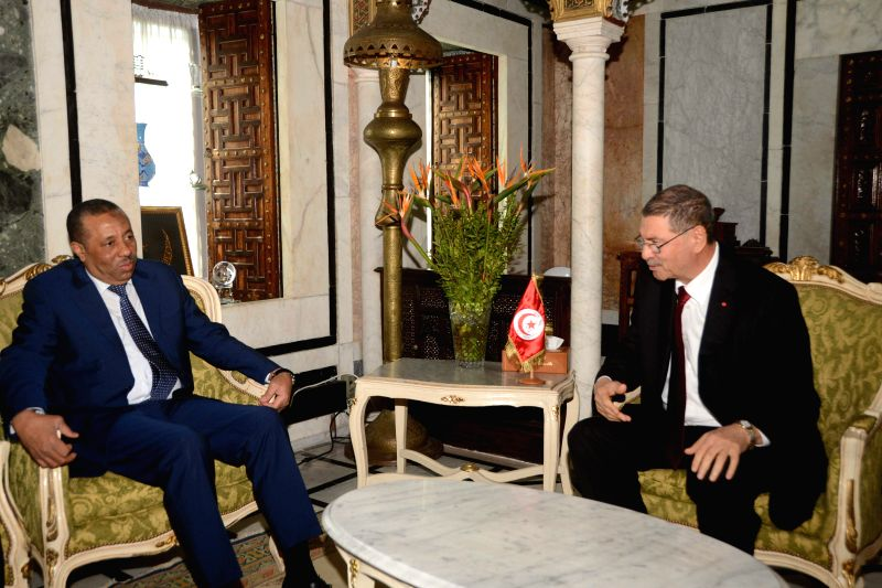 Libya's Prime Minister Abdullah al-Thinni (L) meets with Tunisia's Prime Minister Habib Essid in Tunis, Tunisia on March 31, 2015. The two prime ministers discussed ... - Abdullah