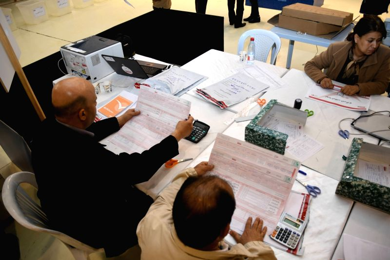 TUNIS, May 7, 2018 (Xinhua) -- Staff members of Tunisian elections authorities count ballots at a counting center in Tunis, capital of Tunisia, May 6, 2018. A leading statistical and polling institute said Sunday evening that early results showed the
