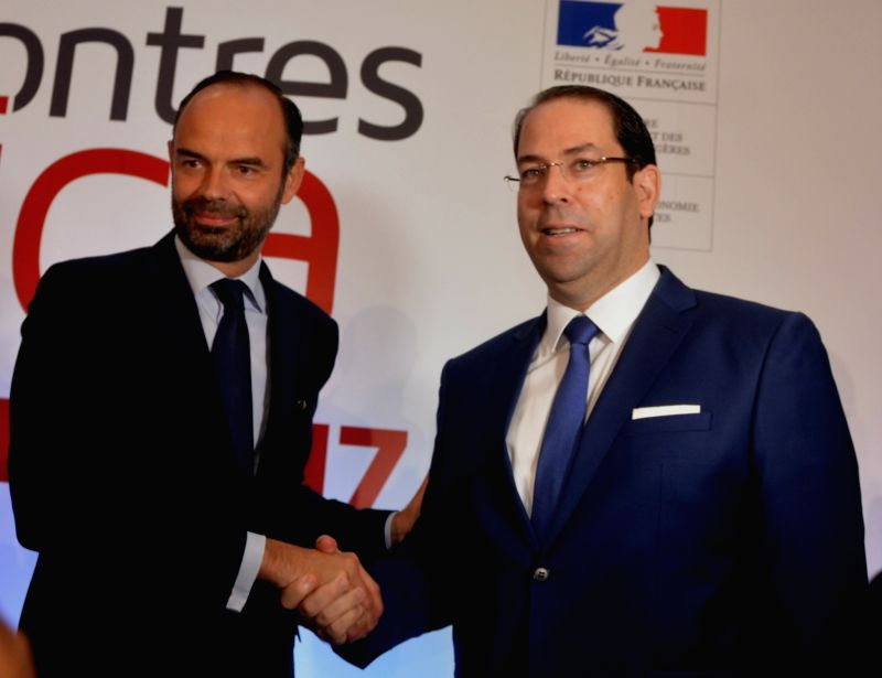 TUNIS, Oct. 6, 2017 - Tunisian Prime Minister Youssef Chahed (R) shakes hands with French Prime Minister Edouard Philippe during the Africa 2017 Forum in Tunis, Tunisia, on Oct. 5, 2017. The 2-day ... - Youssef Chahed