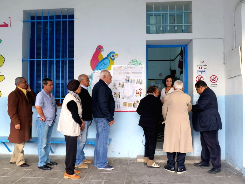 Voters prepare to cast their ballots at a polling station in Tunis, capital of Tunisia, Nov. 23, 2014. Tunisian voters went to polls on Sunday morning to elect the country's first president ...