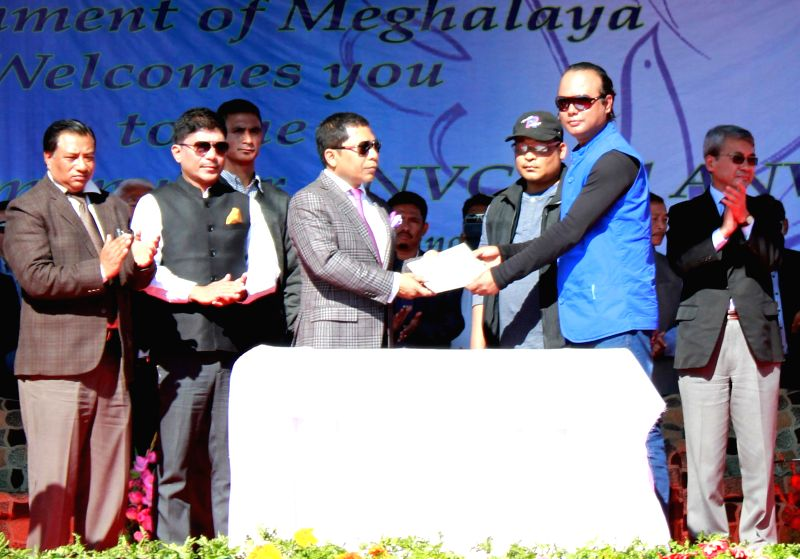 ANVC(B) Chairman Rimphu Marak signs the affirmation agreement, which puts an end to the violent chapter of once tagged as the `most dreaded` rebel group of Meghalaya at Dikki Bandi stadium at ..