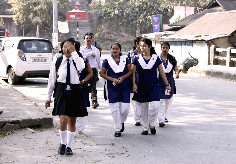 Students walk down to their exam halls in Tura during a 12-hour long bandh called by GNLA across Garo hills in Meghalaya on March 9, 2015.