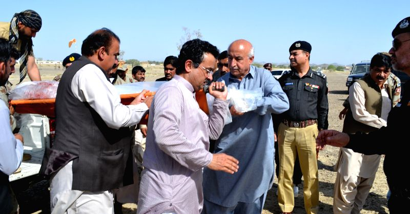 Photo released by Press Information Department (PID) on April 11, 2015 shows Chief Minister Balochistan Dr. Abdul Malik Baloch (C) and other government officials ... - Balochistan D and Malik