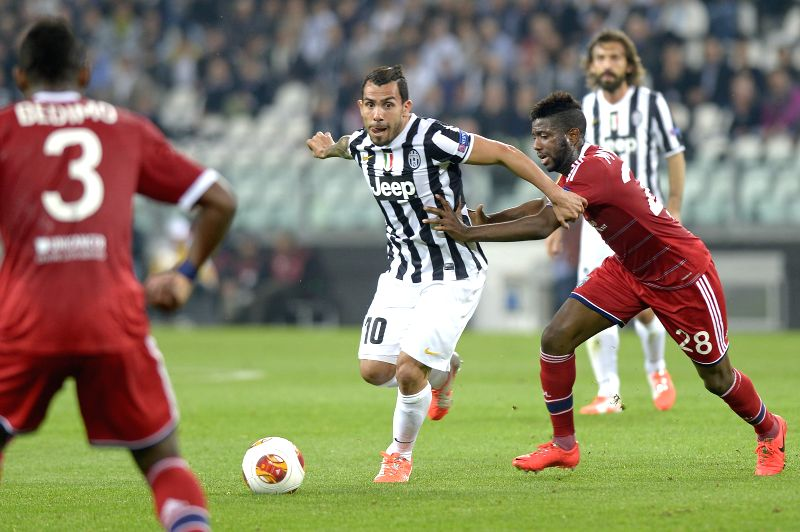 Carlos Tevez (2nd L) of Juventus competes during the quarter-final match against Olympique Lyon at the Europa League in Turin, Italy, on April 10, 2014. Juventus won