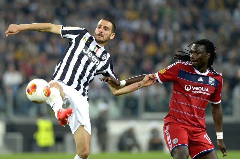 Leonardo Bonucci (L) of Juventus vies with Bafetimbi Gomis of Olympique Lyon during their quarter-final match at the Europa League in Turin, Italy, on April 10, ...