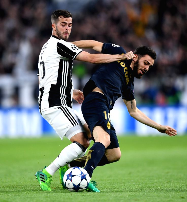 TURIN, May 10, 2017 - Miralem Pjanic(L) of Juventus vies with Bernardo Silva of Monaco during the UEFA Champions League semifinal second leg match between Juventus and Monaco in Turin, Italy, on May ...