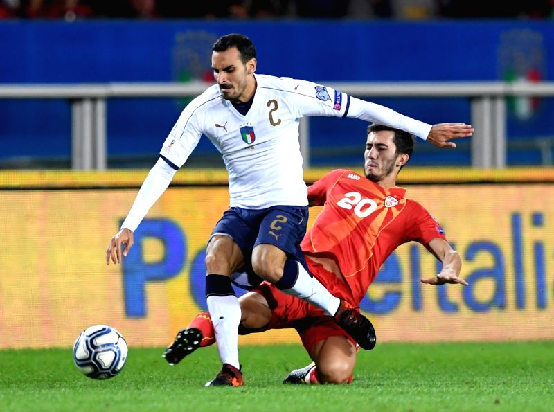 TURIN, Oct. 7, 2017 - Davide Zappacosta (L) of Italy vies with Stefan Spirovski of Macedonia during the FIFA 2018 World Cup Qualifier match between Italy and Macedonia in Turin, Italy, on Oct. 6, ...