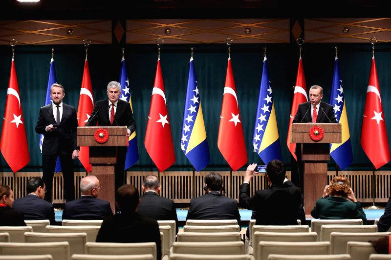 Turkish President Recep Tayyip Erdogan (R) attends a press conference with Presidency Chairman of Bosnia and Herzegovina (BiH) Dragan Covic (2nd L) after their ...