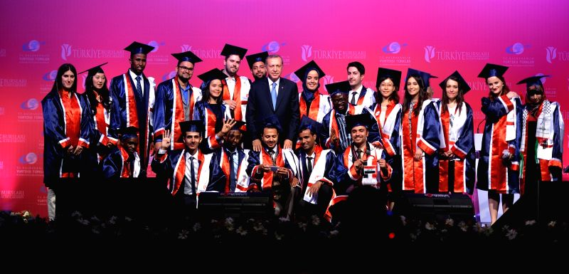 Turkish President Recep Tayyip Erdogan with foreign students.