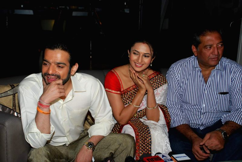 TV actors Karan Patel and Divyanka Tripathi during the celebration of Ye hai Mohabbate completing 300 episodes in Mumbai on Nov 28, 2014. - Karan Patel and Divyanka Tripathi