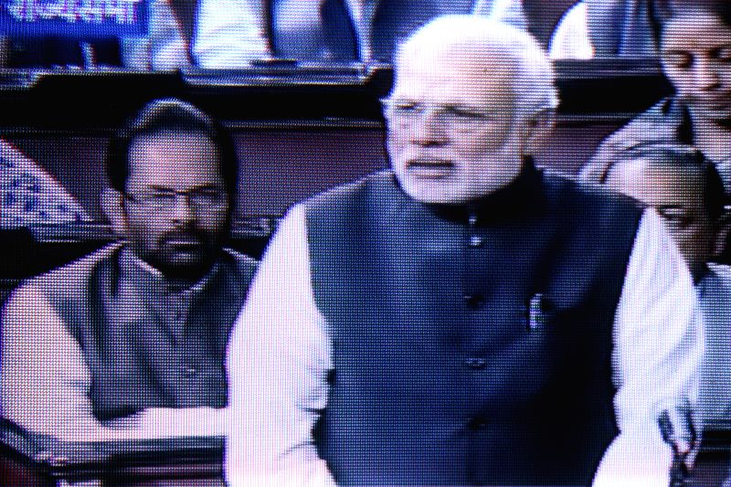 TV GRAB: Prime Minister Narendra Modi addresses at the Rajya Sabha in New Delhi on Dec 4, 2014. - Narendra Modi