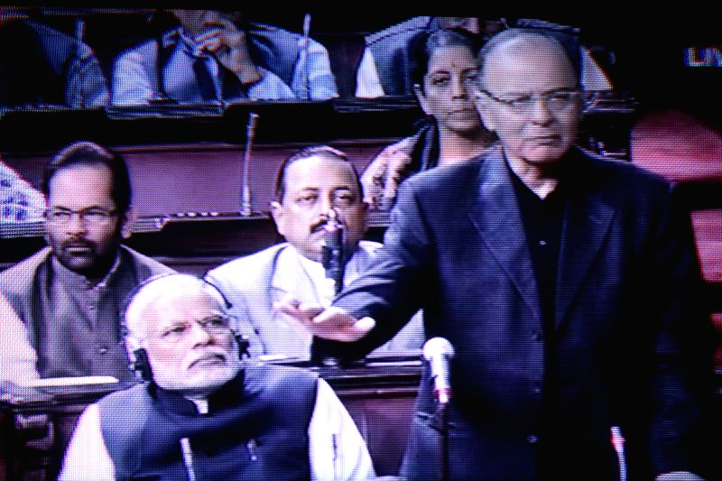TV GRAB: Union Minister for Finance, Corporate Affairs, and Information and Broadcasting Arun Jaitley addresses at the Rajya Sabha in New Delhi on Dec 4, 2014. Also seen Prime Minister Narendra Modi. - Narendra Modi and Arun Jaitley