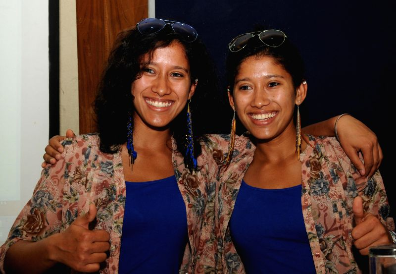 Twin sisters Tashi and Nungshi Malik who are the world's first twin sisters to climb Mt. Everest and world's youngest pair of twin sisters to scale Mt McKinley during a press conference in New ...