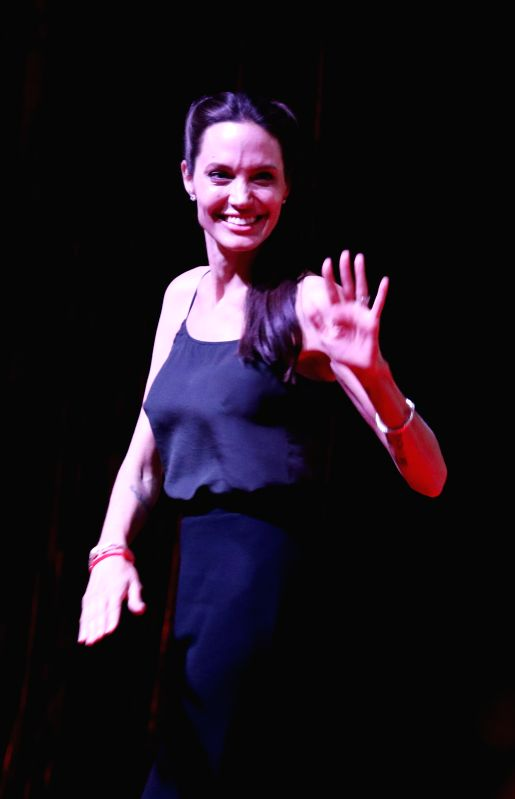 U.S. actress and filmmaker Angelina Jolie Pitt gestures during a conversation on the new generation of Cambodian filmmakers at the Chaktomuk Theater in Phnom ...