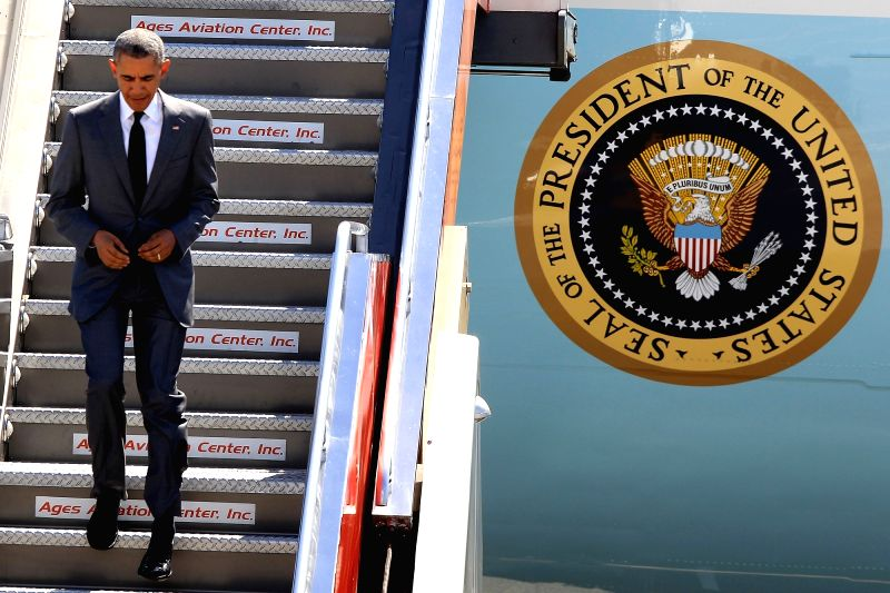 U.S. President Barack Obama steps down the Air Force One upon his arrival for the Asia Pacific Economic Cooperation (APEC) meetings in Pasay City, the ...