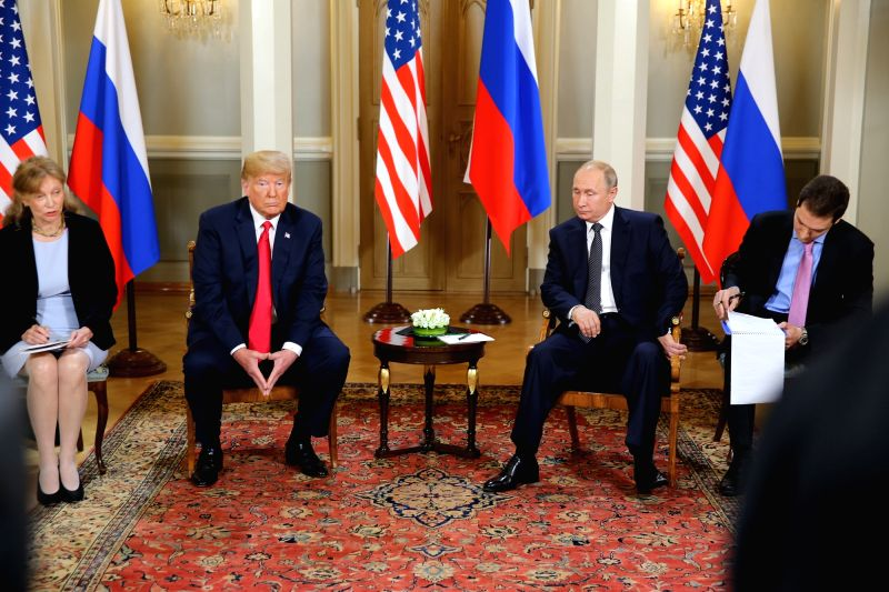 :U.S. President Donald Trump (2nd L) and his Russian counterpart Vladimir Putin (2nd R) meet in Helsinki, Finland, on July 16, 2018. Donald Trump and Vladimir ...