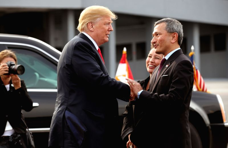 U.S. President Donald Trump (L) shakes hands with Singapore's Foreign Minister Vivian Balakrishnan at an Air Force base in Singapore on June 12, 2018, before boarding Air Force One to get ... - Vivian Balakrishnan