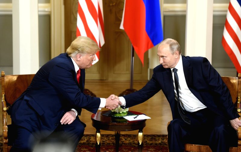 :U.S. President Donald Trump (L) shakes hands with his Russian counterpart Vladimir Putin in Helsinki, Finland, on July 16, 2018. U.S. President Donald Trump and ...