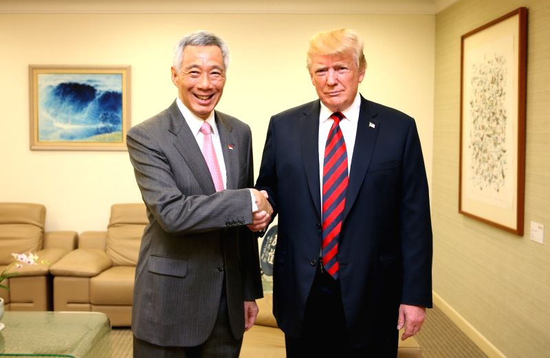 U.S. President Donald Trump (R) shakes hands with Singapore's Prime Minister Lee Hsien Loong at Istana Palace in Singapore on June 11, 2018, in this photo provided by Singapore's Ministry ... - Lee Hsien Loong
