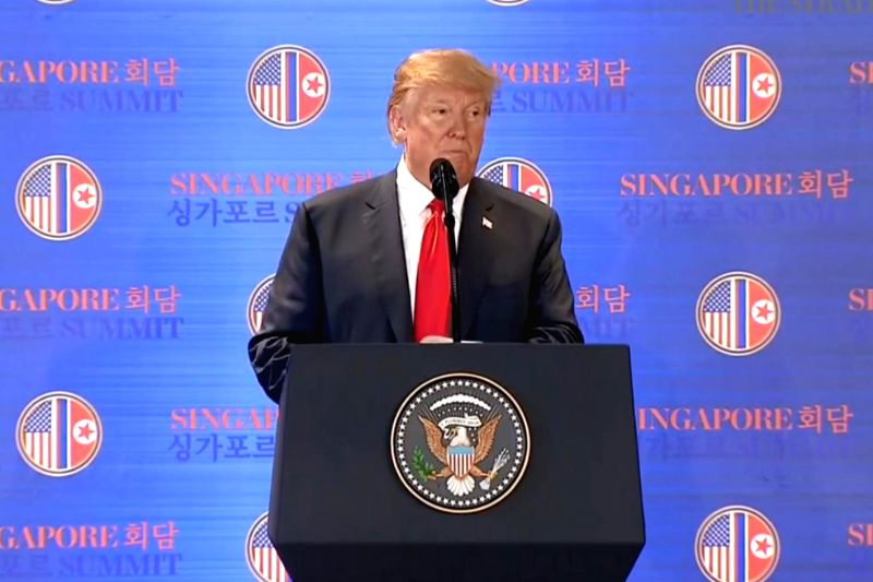 U.S. President Donald Trump speaks at a news conference at the Capella Hotel in Singapore on June 12, 2018, on the outcome of the summit meeting with North Korean leader Kim Jong-un in ...