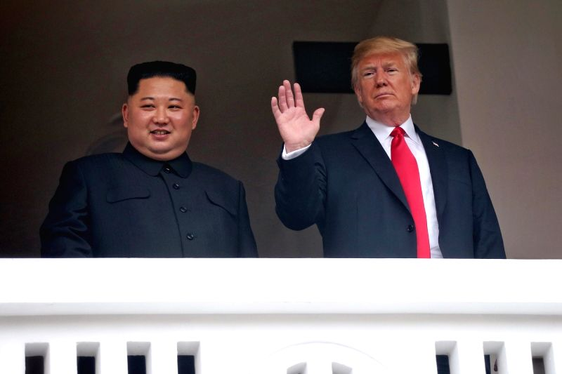 U.S. President Donald Trump waves on the veranda of the Capella Hotel in Singapore on June 12, 2018, while having a one-on-one summit with North Korean leader Kim Jong-un in this photo ...