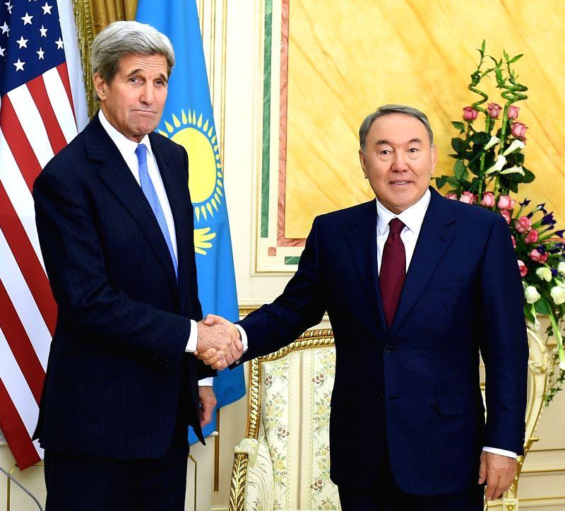 U.S. Secretary of State John Kerry (L) shakes hands with Kazakh President Nursultan Nazarbayev in Astana, Kazakhstan, on November 2, 2015.