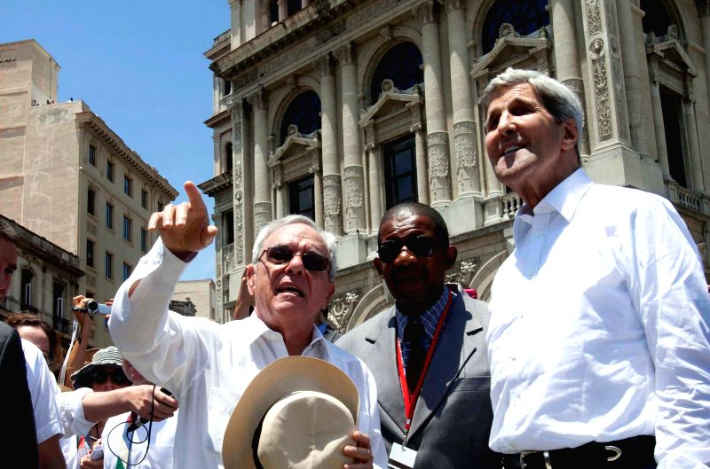 U.S. Secretary of State John Kerry (R) and the historian of Havana Eusebio Leal(L) make a tour at the San Francisco de Asis Square, in Old Havana, in Havana, Cuba, ...