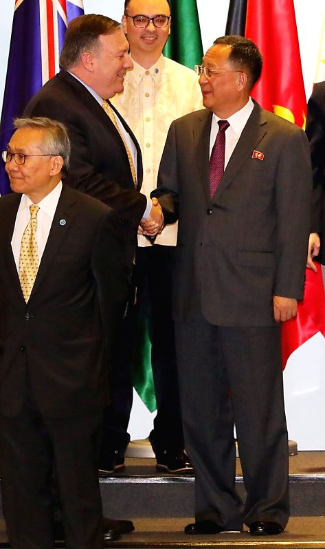 U.S. Secretary of State Mike Pompeo (L) and North Korean Foreign Minister Ri Yong-ho shake hands with each other at the ASEAN Regional Forum held at the Singapore EXPO Convention Center on ... - R
