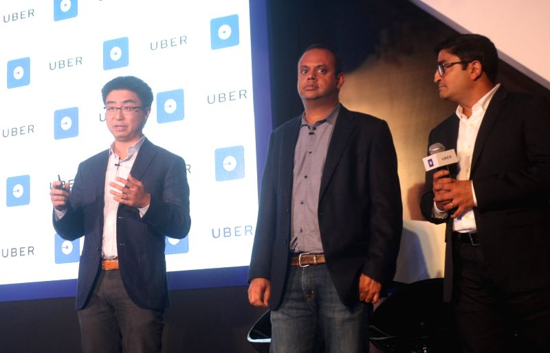 Uber's Head of Product (marketplace and maps) Manik Gupta and Uber's head of rider experience Peter Deng during a programme organised to announce the launch of new app 'Uber Lite', in New ... - Manik Gupta