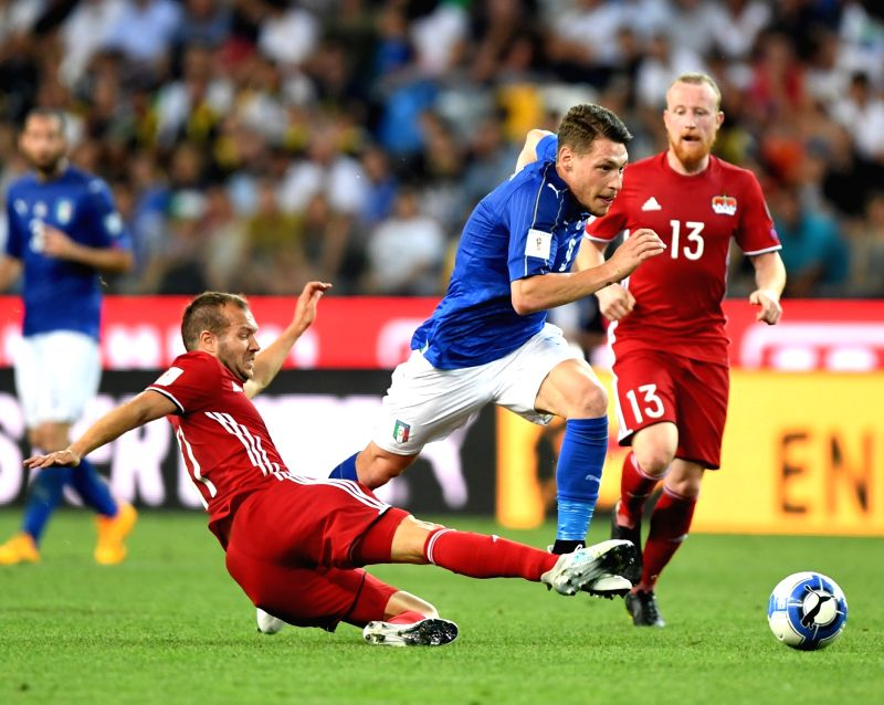 UDINE, June 12, 2017 - Franz Burgmeier of Liechtenstein (L) competes for the ball with Andrea Belotti of Italy during the FIFA 2018 World Cup Qualifying soccer match between Italy and Liechtenstein ...
