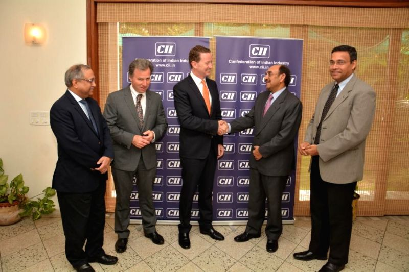 UK Cabinet Minister for Government Policy Oliver Letwin and UK Minister for Business Engagement with India and also Minister of State for Climate Change Gregory Barker with CII President Ajay Shriram - Chandrajit Banerjee