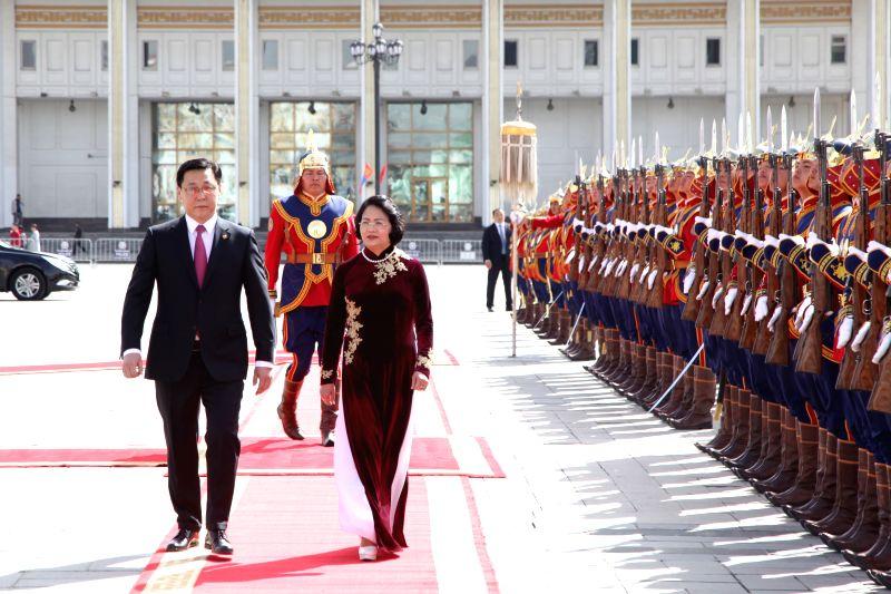 ULAN BATOR, May 8, 2017 - Mongolian Prime Minister Jargaltulga Erdenebat (Front L) and visiting Vietnam Vice President Dang Thi Ngoc Thinh (Front R) inspect the honor guards in Ulan Bator, Mongolia, ... - Jargaltulga Erdenebat
