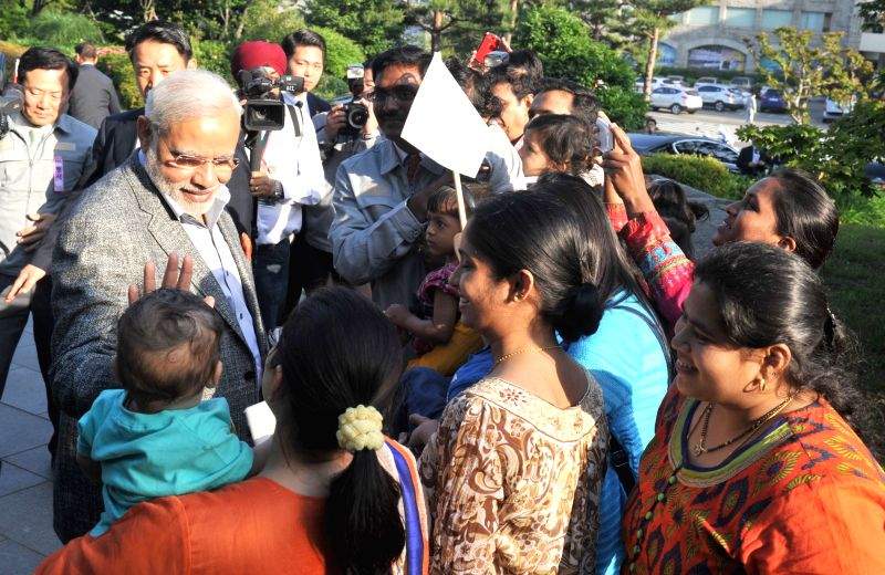 Prime Minister Narendra Modi interacts with the people of Indian Community, at the Hyundai Heavy Industries Shipyard, in Ulsan, South Korea on May 19, 2015. - Narendra Modi