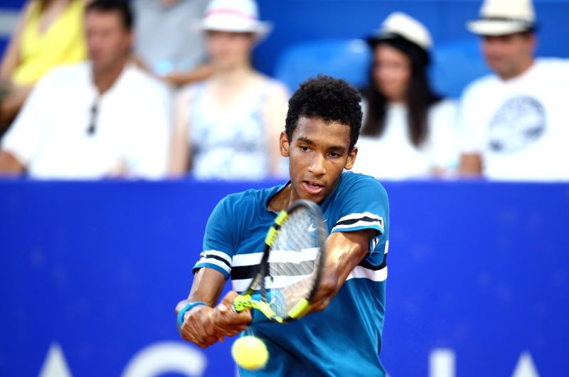 UMAG, July 20, 2018 - Felix Auger Aliassime of Canada hits a return to Andrey Rublev of Russia during the second round of 2018 ATP Croatia Open in Umag, Croatia, on July 19, 2018. Felix Auger lost ...