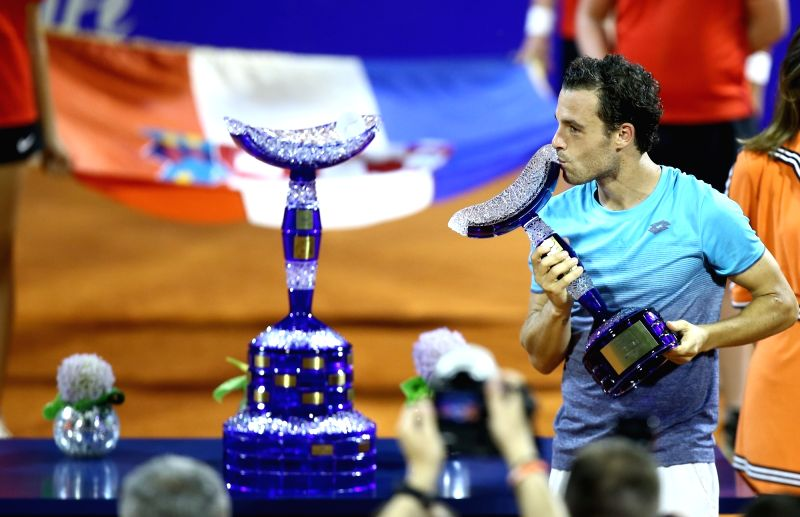 UMAG, July 23, 2018 - Marco Cecchinato of Italy kisses his trophy during the awarding ceremony after winning men's singles final of 2018 ATP Croatia Open in Umag, Croatia, on July 22, 2018.
