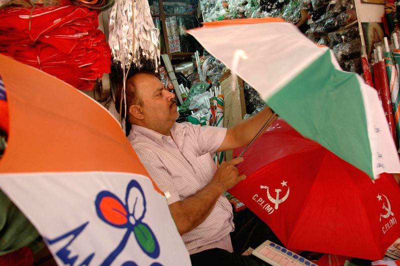 Umbrellas depicting political symbols on display at a shop in Kolkata on April 27, 2014.
