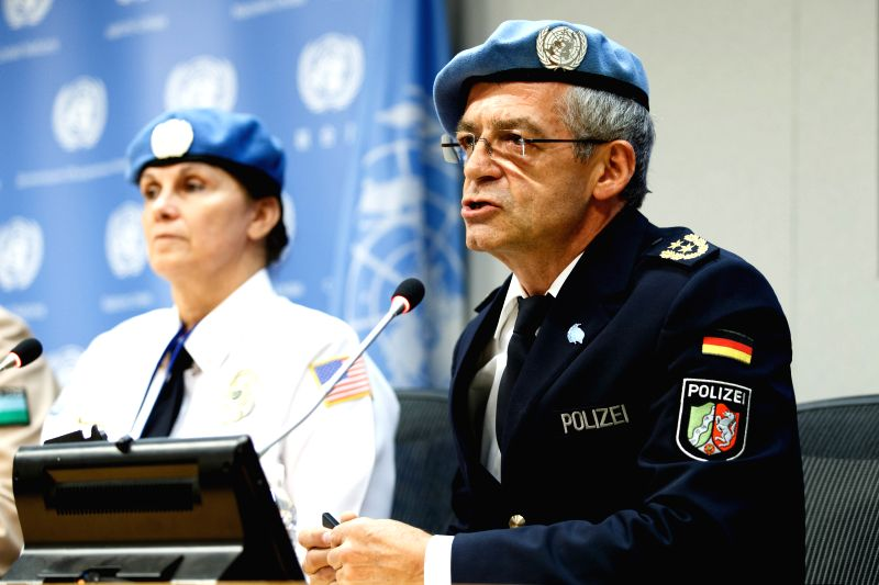 UN's top police official Stefan Feller (R) addresses a press conference at the UN headquarters in New York Nov. 12, 2015. In a world where crime increasingly has ...