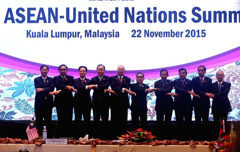 UN Secretary-General Ban Ki-moon (4th L) poses for a family photo with Association of Southeast Asian Nations (ASEAN) leaders and representatives at the 7th ...