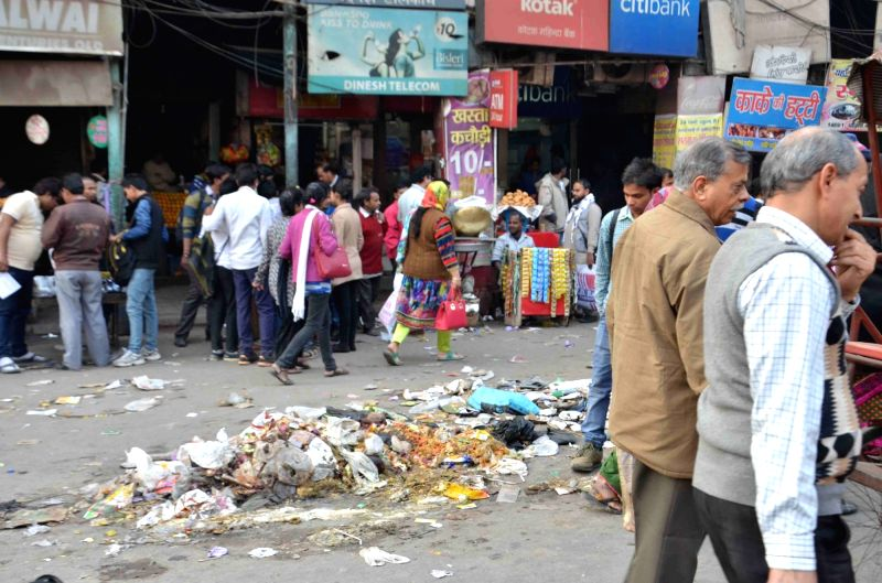 Unattended garbage lay on streets on World Earth Day in New Delhi on April 22, 2017.