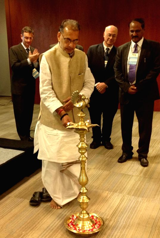Union Agriculture Minister Radha Mohan Singh lights the inaugural lamp during the 33rd Session of Asia-Pacific Fishery Commission (APFIC) in Hyderabad on June 23, 2014. - Radha Mohan Singh