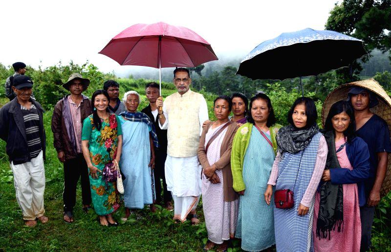 Union Agriculture Minister Radha Mohan Singh visits an organic farm, at Lawsohtun, Meghalaya, on July 29, 2018. - Radha Mohan Singh