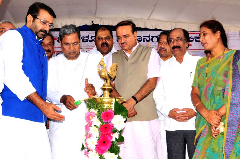 Union Chemicals and Fertilizer Minister Ananth Kumar with Karnataka Chief Minister Siddaramaiah, Bangalore Mayor B S Satyanarayana and others during inauguration of various development projects in ...