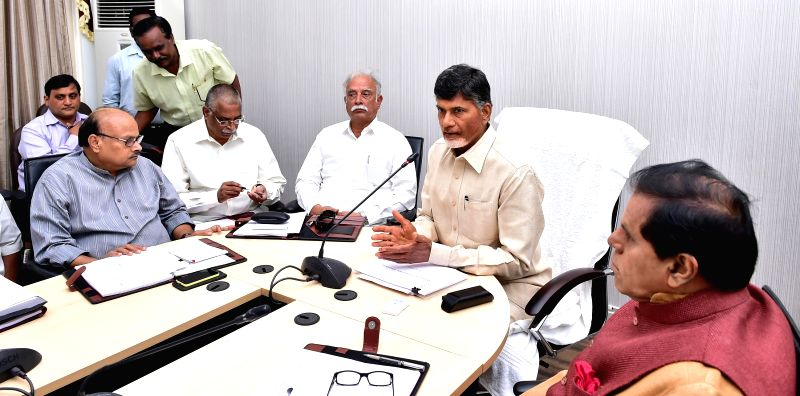 Union Civil Aviation Minister Ashok Gajapathi Raju and Andhra Pradesh Chief Minister N. Chandrababu Naidu during a meeting in Hyderabad on July 6, 2014. - N. Chandrababu Naidu