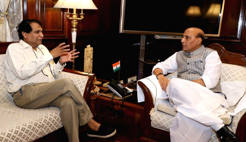 Union Commerce and Industry and Civil Aviation Minister Suresh Prabhakar Prabhu calls on Union Home Minister Rajnath Singh, in New Delhi on July 26, 2018. - Suresh Prabhakar Prabhu and Rajnath Singh