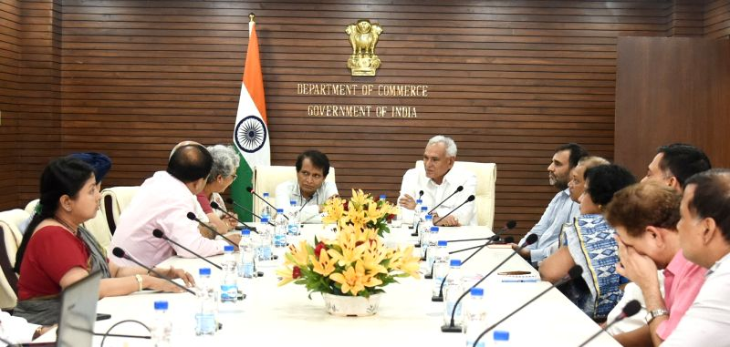 Union Commerce and Industry Minister Suresh Prabhakar Prabhu addresses during  inauguration of a conference hall in New Delhi on June 8, 2018. Also seen Union MoS Commerce and Industry ... - Suresh Prabhakar Prabhu and R. Chaudhary