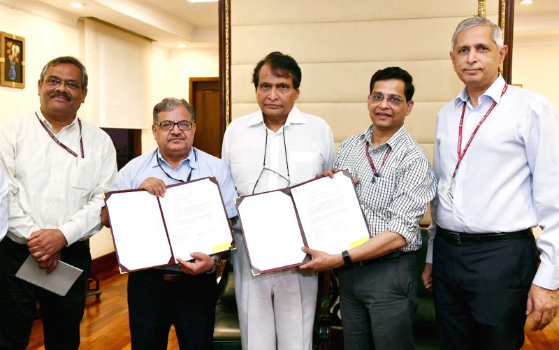 Union Commerce and Industry Minister Suresh Prabhakar Prabhu witnesses the signing of an MoU between the logistics wing of Department of Commerce and Indian Institute of Foreign Trade ... - Suresh Prabhakar Prabhu